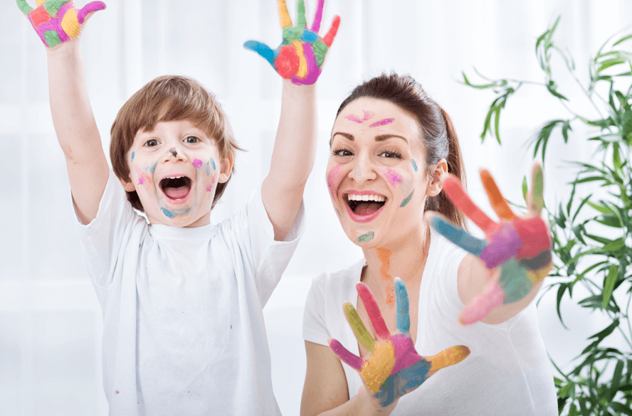 mother and son finger painting